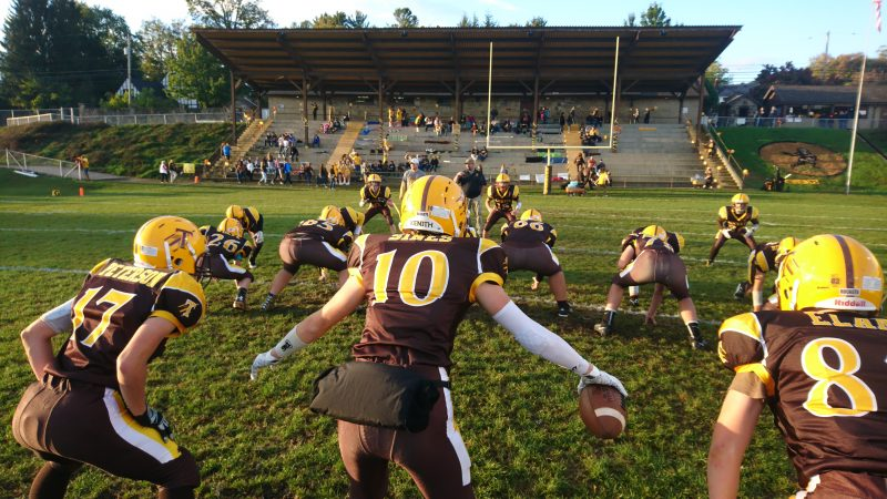 The Titusville High School football team warms up before the homecoming game (Kevin McCorry/Keystone Crossroads)