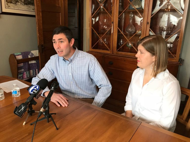 Stewart Greenleaf Jr., a Republican attorney, announces he will run for the 12th District state Senate seat his father will vacate; his wife Heather by his side. (Dana DiFilippo/WHYY)