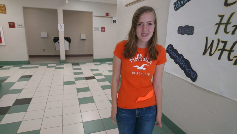 Titusville High School freshman Abigail Bryan lives on a nearby farm (Kevin McCorry/WHYY)