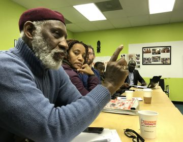 Stanley Straughter, a member of the Mayor's Commission on African and Caribbean Immigrant Affairs, speaks during a strategizing meeting of African and Caribbean community members on January 13, 2018 at Southwest Community Development Corporation in Philadelphia. (Laura Benshoff/WHYY)