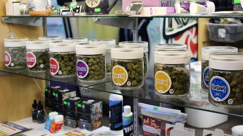 Like an old fashioned candy store varieties of marijuana are display in jars. (Bill Barlow/for WHYY)