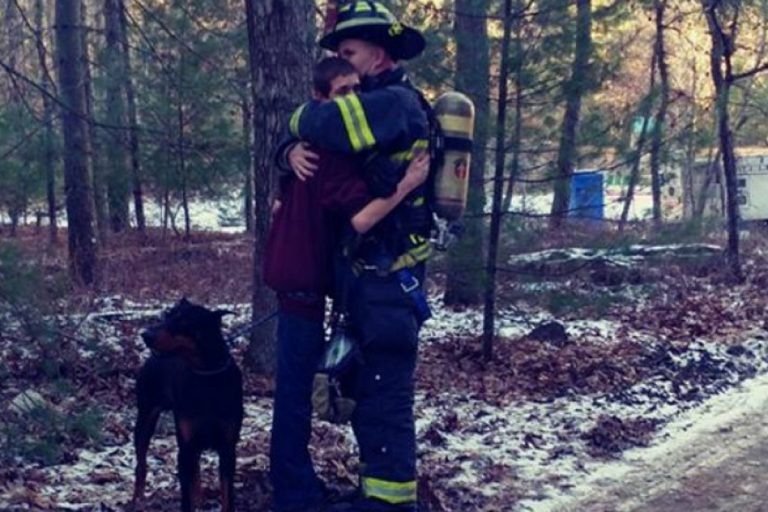 Tabernacle Fire Lt. Jason Penwell hugs his 15-year-old son after responding to a blaze that gutted his family's home Wednesday. (Maryann Smith)