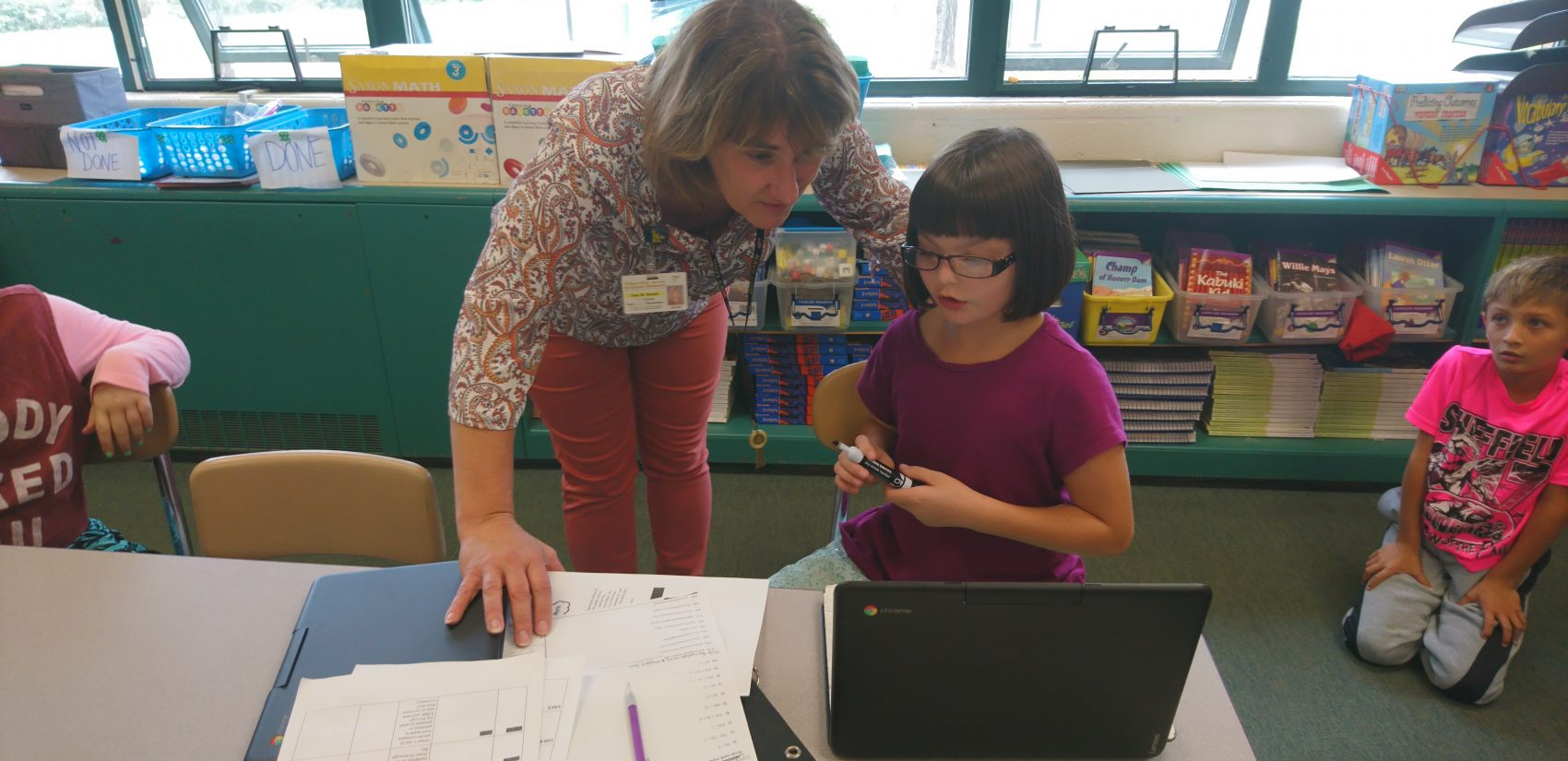 Principal Lisa Royek works with a student at Titusville's Hydetown Elementary (Kevin McCorry/Keystone Crossroads)