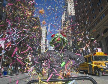 Brendan Ireland, a member of Philadelphians for Mummery tossed confetti as he marched the parade route.