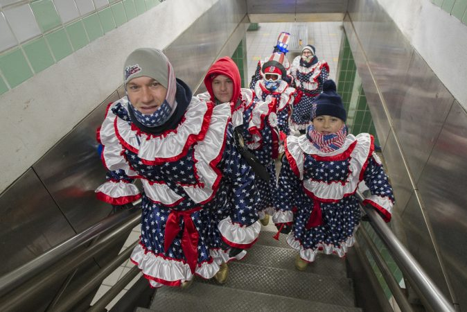 En route to the parade, a group of the Jesters New Years Brigade climb the stairs of the Spring Garden Station on the Broad Street Subway.