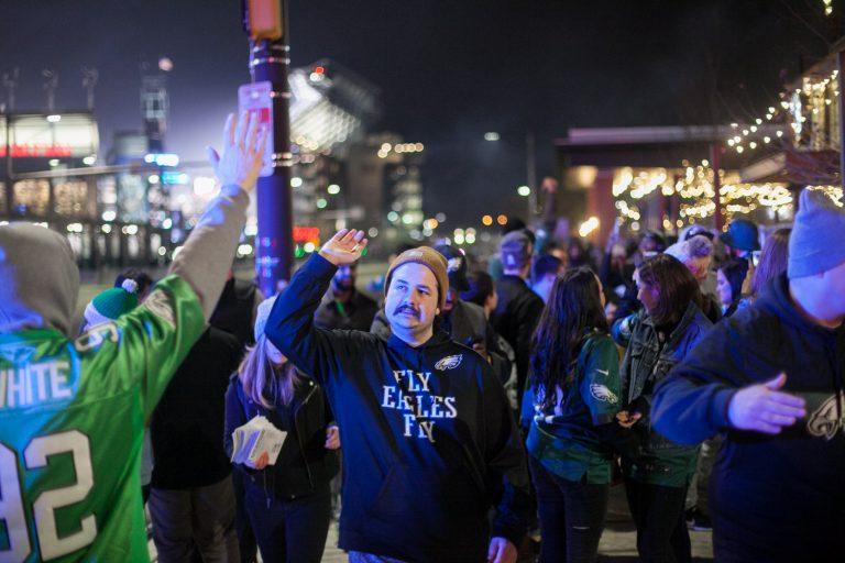 Eagles Fans celebrate near Xfinity Live. (WHYY)