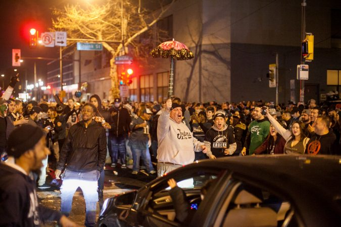 Eagles Fans celebrate on South Broad Street after their win over the Minnesota Vikings in the NFC Championship Game Sunday. (Brad Larrison for WHYY)
