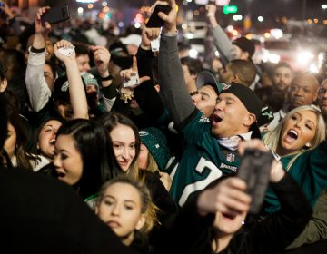Eagles fans cheer outside of Xfinity Live after an Eagles touchdown in the NFC Championship Game against the Minnesota Viking Sunday Night. (Brad Larrison for WHYY)