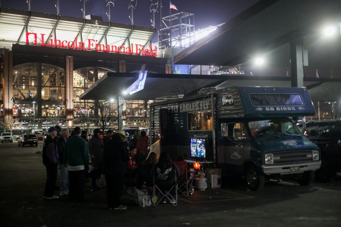 Eagles fans watch the NFC Championship Game against the Minnesota Vikings from their R.V in the parking lot of Lincoln Financial Field Sunday night. (Brad Larrison for WHYY)