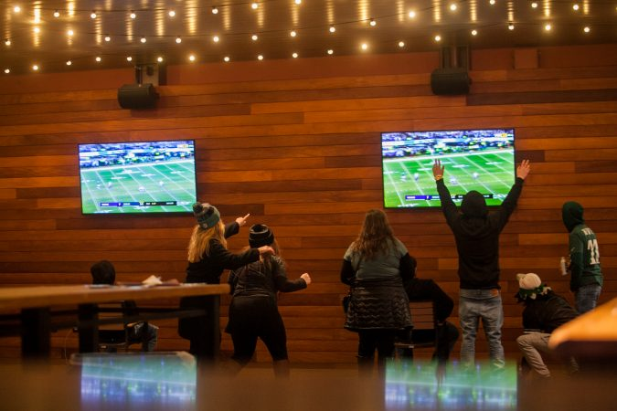Eagles fans celebrate as the Eagles score yet another first half touchdown against the Minnesota Vikings in the NFC Championship Game Sunday Night. (Brad Larrison for NewsWorks)