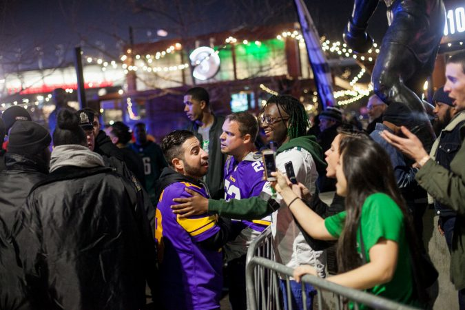 A minor scuffle between Eagles and Vikings fans outside of Xfinity LIve after the NFC Championship Game at Lincoln Financial Field Sunday Night. (Brad Larrison for WHYY)
