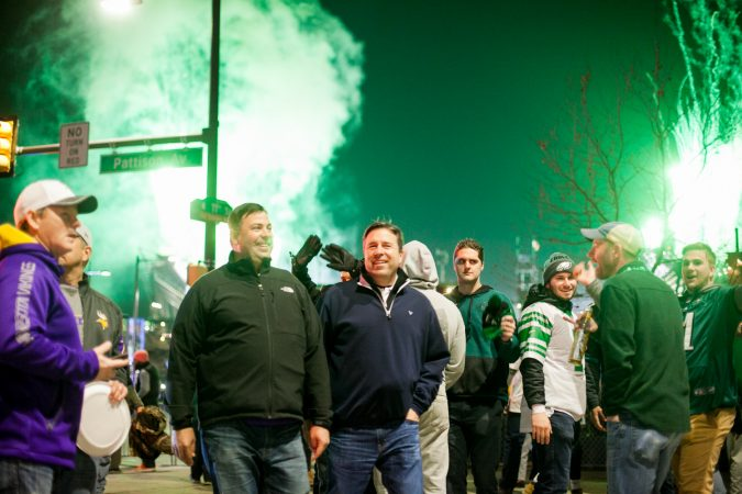 Eagles fan walk down Pattison Avenue in South Philadelphia following their win over the Minnesota Vikings in the NFC Championship Game Sunday Night. (Brad Larrison for WHYY)