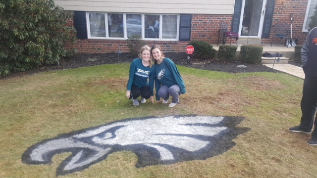 Lauren Bruton and Erin Lynch helped stencil 10 lawns with the Eagles logo