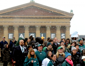 PMA staff gathers to sing the Eagles Fight Song ahead of the Super Bowl. (Kimberly Paynter/WHYY)