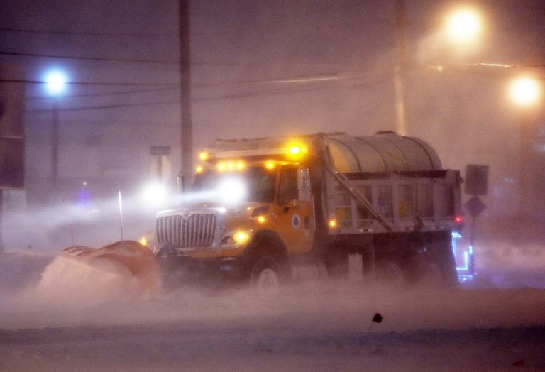 A DelDOT snow plow clears the roads near Rehoboth Beach on Thursday. (Chuck Snyder/for WHYY)