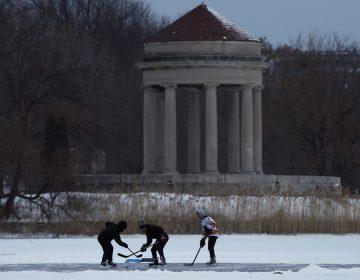 Youths play ice hockey on a frozen pond at Franklin Delano Roosevelt Park during a winter storm, Thursday, Jan. 4, 2018, in Philadelphia. (Matt Slocum/AP Photo)