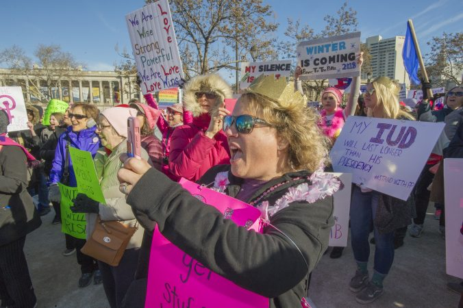 Marchers cheer the Drum Like A Lady group at Logan Circle. (Jonathan Wilson for WHYY)
