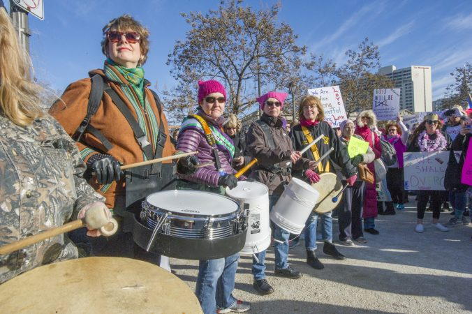 Members of the Drum Like a Lady group entertain marchers. (Jonathan Wilson for WHYY)