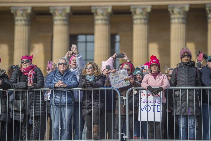 Marchers gather at the top of the Philadelphia Art Museum steps to watch the speakers below. (Jonathan Wilson for WHYY)