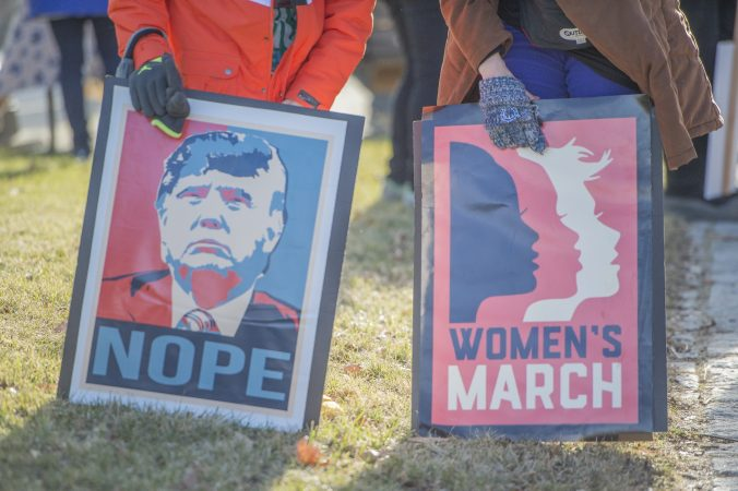 2 of the many protest signs at the march. (Jonathan Wilson for WHYY)
