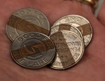 A handful of SEPTA tokens. (Emma Lee/WHYY)