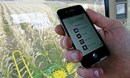 In this file photo, Tony Pouliot demonstrates the goCrop app on his mobile photo in the cab of his combine on his farm in Westford, Vt. (Toby Talbot/AP)