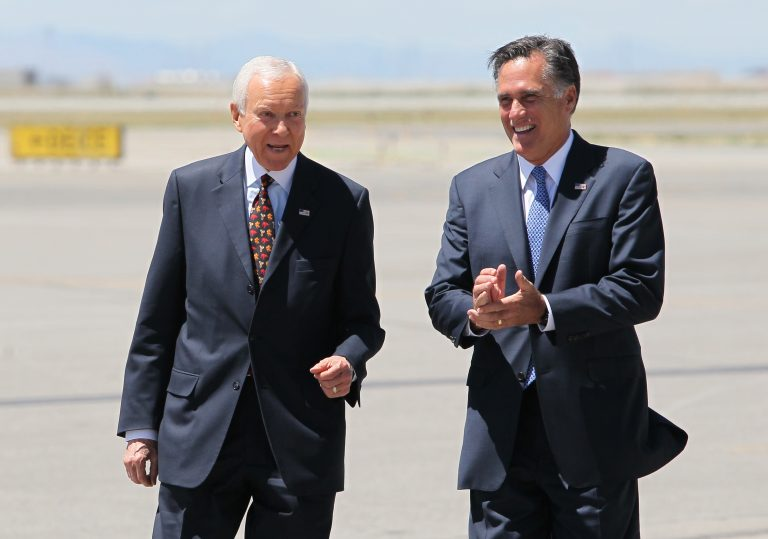 In this June 8, 2012 file photo, Mitt Romney, right, laughs walking side-by-side with Sen. Orrin Hatch, R-Utah, who met him on the tarmac at Salt Lake International Airport.