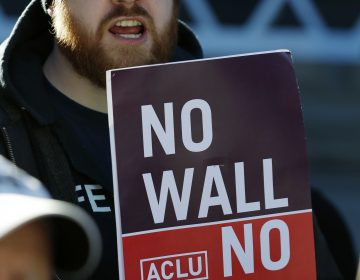 Protesters outside the courthouse where 9th Circuit Court of Appeals judges were hearing Hawaii's challenge last month to the Trump administration's latest travel ban. (Ted S. Warren/AP)