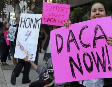 Demonstrators urging the Democratic Party to protect the Deferred Action for Childhood Arrivals Act (DACA) rally outside the office of California Democratic Sen. Dianne Feinstein in Los Angeles last week.