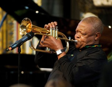 South African jazz musician Hugh Masekela performs during the Observance for Commonwealth Day service at Westminster Abbey in central London in March 2012.