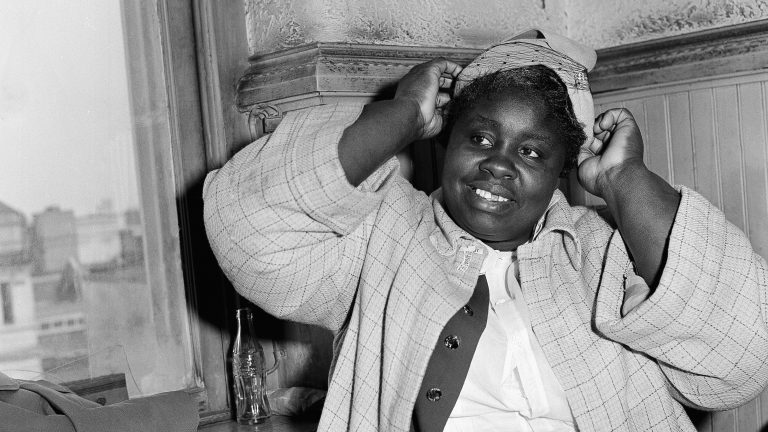 Georgia Gilmore adjusts her hat for photographers in 1956 during the bus boycott trial of Rev. Martin Luther King Jr. in Montgomery, Ala. She testified: