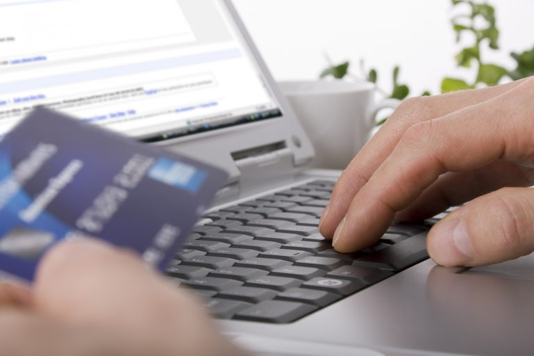 Online shopping using a credit card to complete an e-commerce transaction