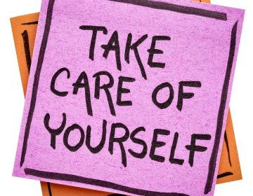 Self-care reminder written on an isolated sticky note. (Photo Courtesy BigStock)
