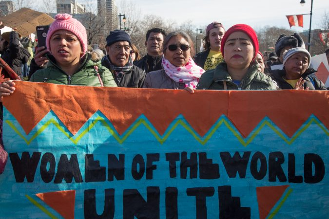 Immigrants stand together at the 2018 Women's March on Philadelphia Saturday. (Emily Cohen for WHYY)