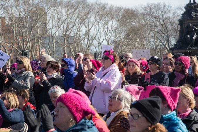 Marchers listen to the speakers at the rally of the 2018 Women's March on Philadelphia, January 20, 2018. (Emily Cohen for WHYY)