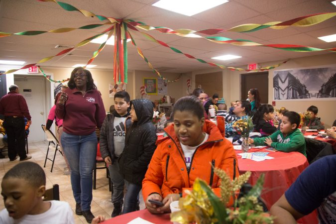 APM threw a Three Kings Day/Octavious celebration for diplaced families from Puerto Rico who have found their way to Philadelphia on January 12 2018. (Emily Cohen for WHYY)