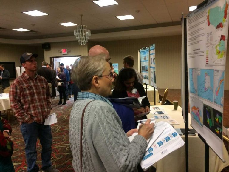 At a public information session in Dover, Delaware, Thursday, Charlotte Reid looks over information about the Trump administration's plan to expand oil and gas drilling along the Atlantic coastline. She fears that could put Delaware at risk of a spill.