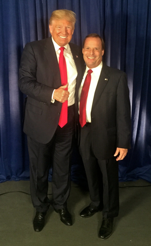 A photo of Ellis with candidate Donald Trump taken in April of 2016 is displayed in his office.