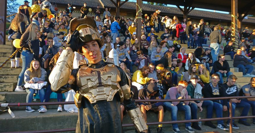 Isaac Bowens plays the Titusville 'Rocket Man' mascot during the homecoming football game (Kevin McCorry/Keystone Crossroads)