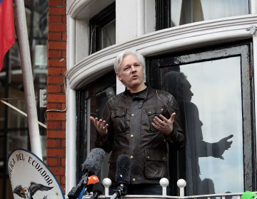 Julian Assange speaks to the media from the balcony of the Embassy of Ecuador on May 19, 2017, in London. (Jack Taylor/Getty Images)