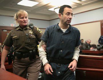 Larry Nassar appears in court last Wednesday in Lansing, Mich., to listen to victim impact statements during his sentencing hearing. He is accused of molesting more than 100 girls while he was a physician for USA Gymnastics and Michigan State University.