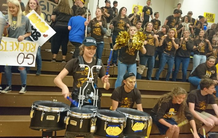 Titusville senior Samantha Pritchard plays in the drumline during the homecoming pep rally.  (Kevin McCorry/WHYY)