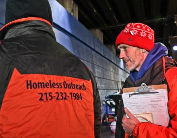 Luke Dunn talks to a homeless man and takes down his contact to make sure he gets entered into the homeless database, and promises to return for a referral for an I.D.