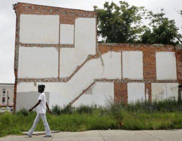 A woman walks through a Philadelphia neighborhood.