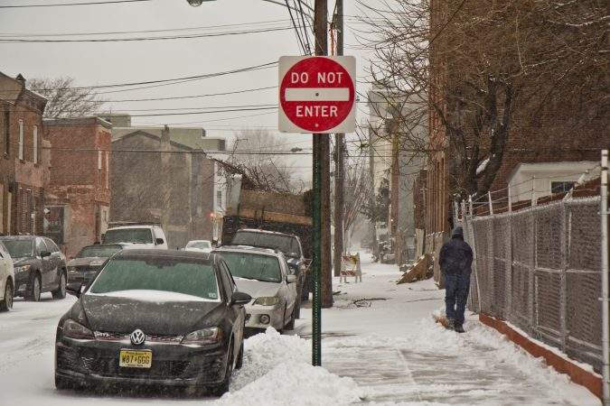 A Kensington resident works to keep the sidewalk clear. (Kimberly Paynter/WHYY)