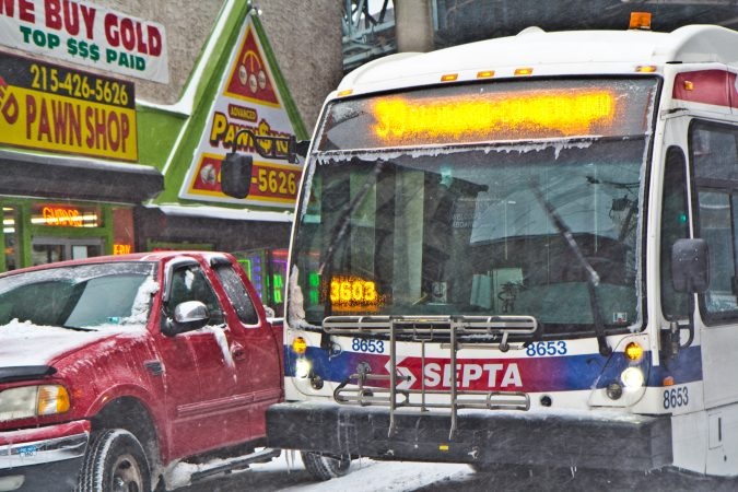 Snow and ice coat a SEPTA bus on Jasper Street in Kensington. (Kimberly Paynter/WHYY)