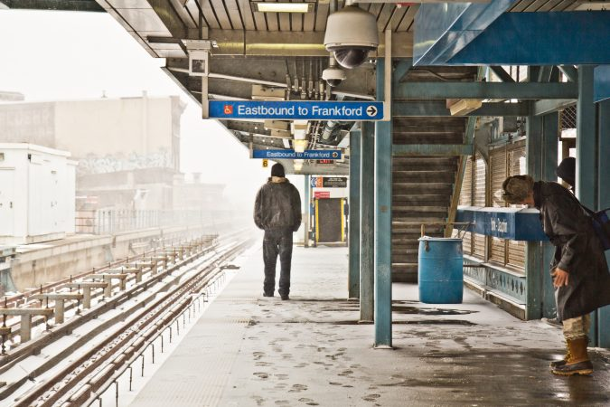 Commuters await the elevated train on the York-Dauphin platform. (Kimberly Paynter/WHYY)