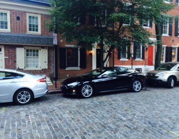 Tesla plugged in at the EV-only zone on Delancey St. (Jim Saksa/WHYY)
