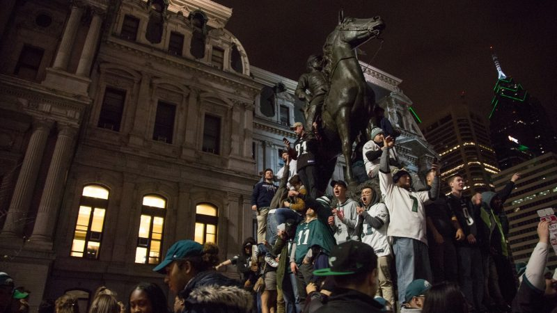 Fans celebrate after the Eagles win the NFC championships and secure a spot in the Super Bowl. (Emily Cohen for WHYY)