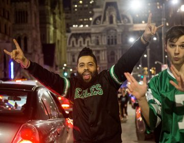 Fans celebrate after the Eagles win the NFC championships and secure a spot in the Super Bowl.